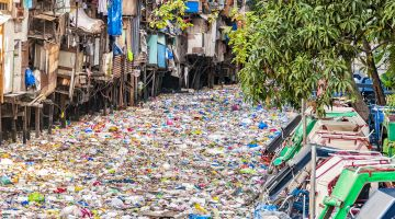 A river in Asia polluted with plastic waste