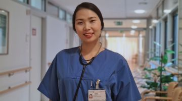 Kieu Oanh in her working clothes at Rostock University Medical Center