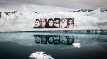 Barbara Dombrowski hung portraits of people from Greenland and the Amazon on an iceberg.