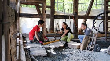 Preserving cultural heritage: an international team of volunteers at work.