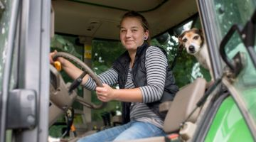 Handling tractors and animals in an agricultural engineering internship.
