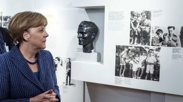 Merkel honors Hitler assassins, laments rise of far right
