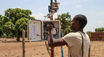 A scientist at a weather station in Burkina Faso