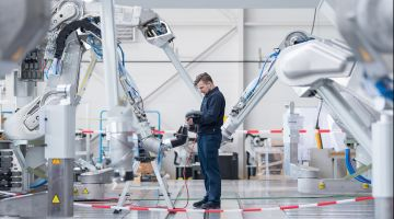 A Dürr AG employee tests a painting robot.