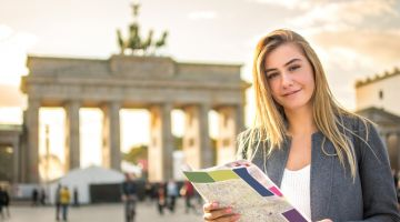 A tourist at the Brandenburg Gate in Berlin