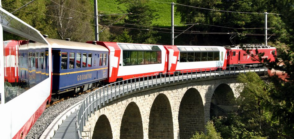 Through valleys and through mountains, but always on time: the Swiss railway