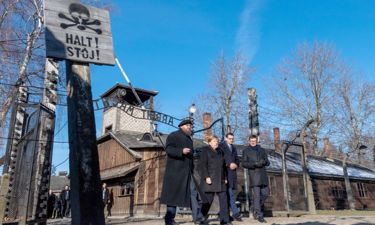 Federal Chancellor Angela Merkel visits Auschwitz with Poland's Prime Minister Mateusz Morawiecki in December 2019. Also present: Piotr Cywinski (far left), Director of the Auschwitz-Birkenau State Museum, and his deputy Andrzej Kacorzyk (far right)