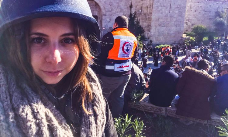 "Reporter Sarah Fantl ""catching stories"" in Jerusalem."