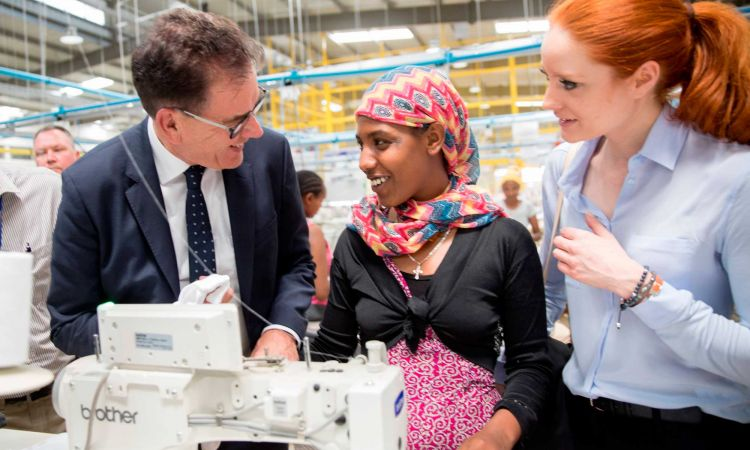 Minister of Economic Cooperation Gerd Müller in a modern textiles factory in Addis Ababa, Ethiopia