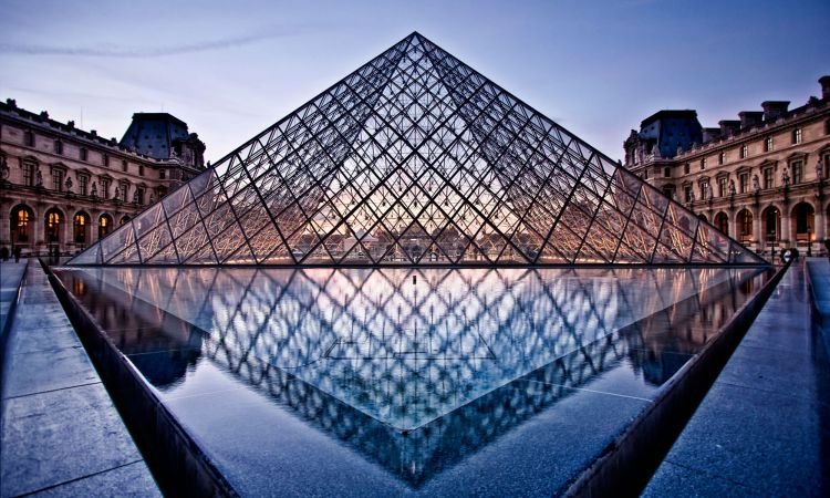 Damaged UFO? Ieoh Ming Pei's glass pyramid in front of the Louvre in Paris, France