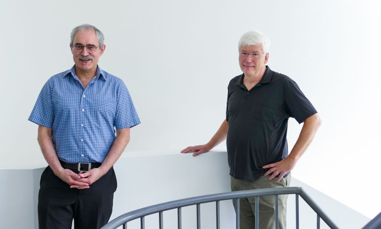 DFKI professors Josef van Genabith (left) and Stephan Busemann.