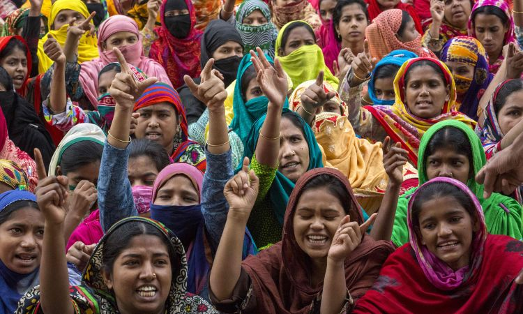 Women textile workers in Bangladesh demonstrate for better pay.