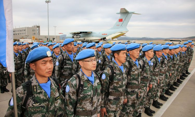 Chinese soldiers wearing the blue beret of the UN.