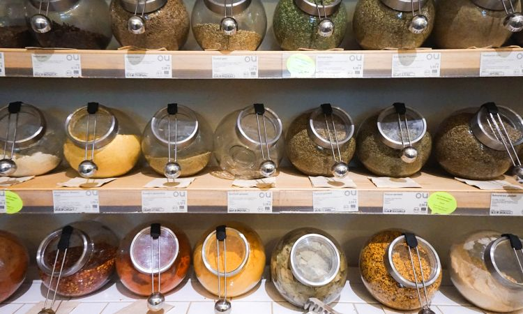 Spices and tea are stored in screw-top jars.